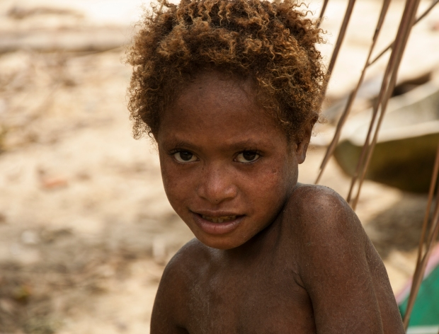 Smile From Kamaka girl. Kamaka is a small village in Triton Bay, Kaimana, West Papua. In this Village children usually play on the beach.