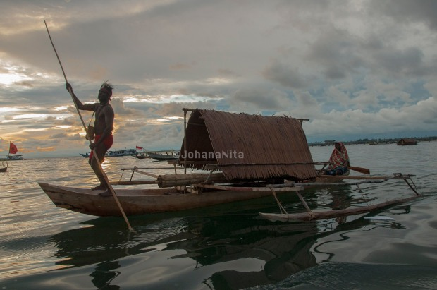 Semang Canoe - a traditional Canoe from Maerasi Tribe -Kaimana in West Papua. In the past, this canoe  is used as a residence (houseboat). All activities carried out in them, such as cooking and sleeping. Canoe is made from a whole tree, which dredged the middle. The roof, use of sago palm thatch.